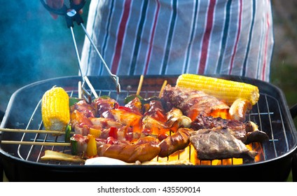 The men were on the barbecue grill meat and vegetables