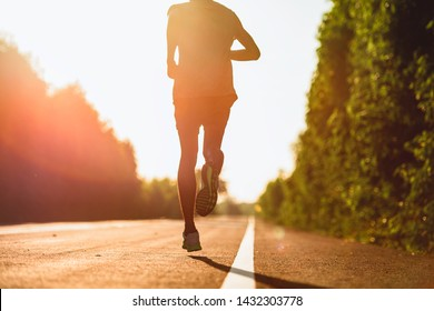 Men who exercise by running going the road.