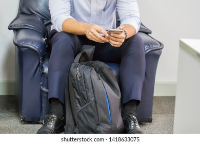 Men who are using mobile phones to work in free time.