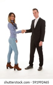 men and woman shake hands and look at you
