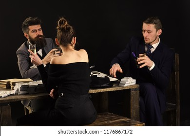 Men and woman sitting at table with piles of money. Illegal deal concept. Businessmen discussing illegal deal while drinking and smoking, dark interior background. Company engaged in illegal business
