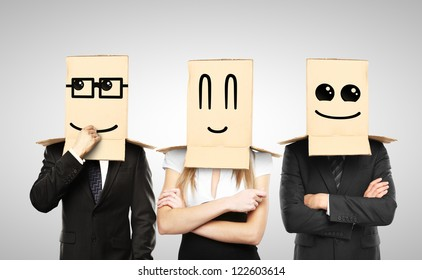 men and woman with smiling box on head
