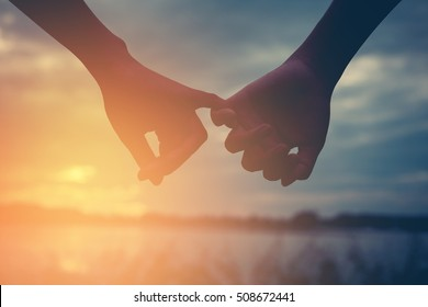 Men and women couples holding hand happily at sunset