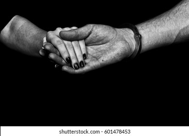 men and women cuffed hands together