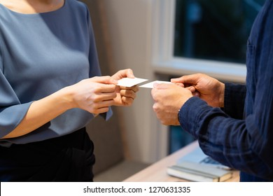 Men and women exchanging business cards