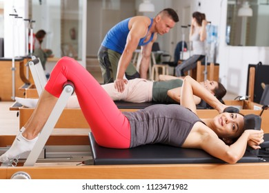 Men and women in the gym during the exercises