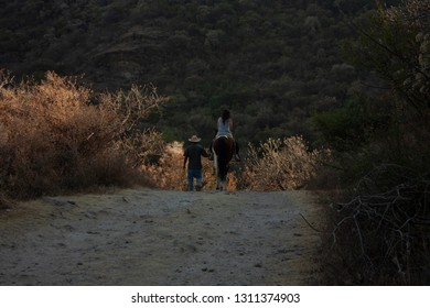 Men, women and horses doing trekking on a large hill of the speaker in a state of Mexico