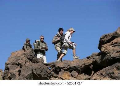 Men and women making some hike