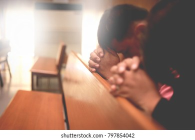 Men and women are praying to God in the church.