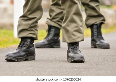 Men and women from Republican Sinn Fein, wear paramilitary uniforms