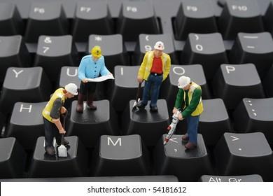 Men At Work on Computer Keyboard