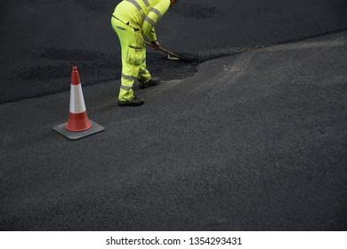 Men at work. Street paving repair work