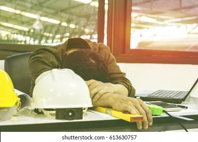 Men work tired and fall asleep after hard work light sunset background.