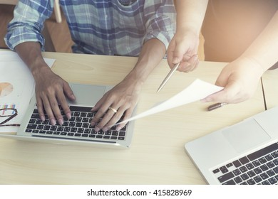 men working with business document and laptop computer notebook, vintage tone