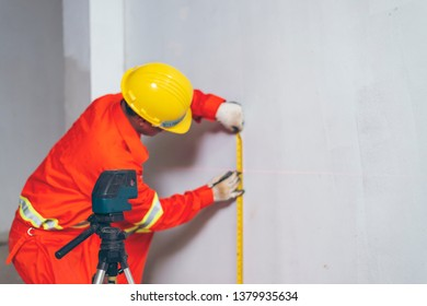 Men and working with laser level machines