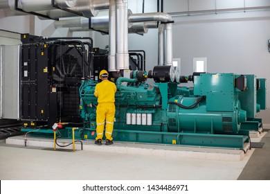 Men working on diesel generator