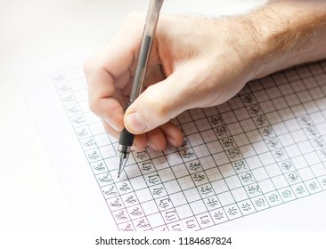 The men writting in sheet of paper with Chinese characters, the beginning of learning Chinese, pronouns