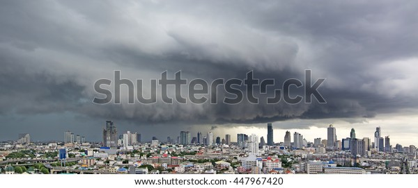 Menacing Thunderstorm above Bangkok city life background