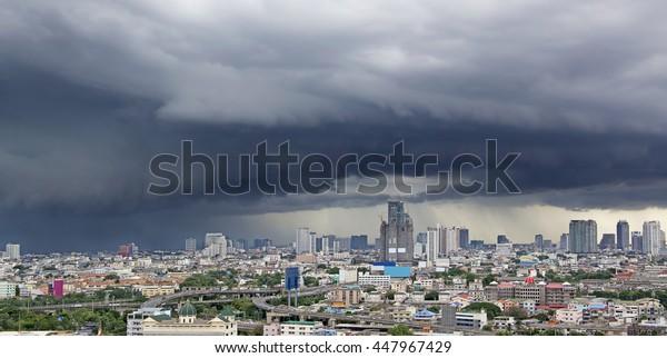 Menacing Thunderstorm above Bangkok city life background
