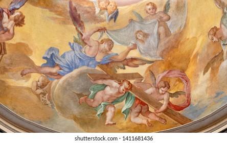 MENAGGIO, ITALY - MAY 8, 2015: The baroque fresco of angels with the corss in church Chiesa di Santa Marta.