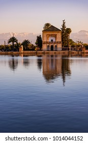 Menara Gardens Pavilion reflect in water at sunset,Morocco at sunset. Water reflection.