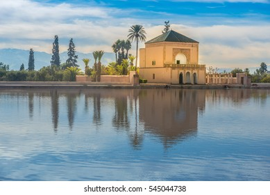 Menara gardens reflecting pool and pavilion with the snow capped Atlas mountains in the background, Marrakech, Morocco.