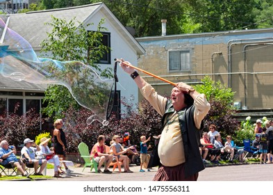 MENDOTA, MN/USA –JULY 13, 2019: The Baron of Bubble entertains crowd at annual Mendota Days Parade.