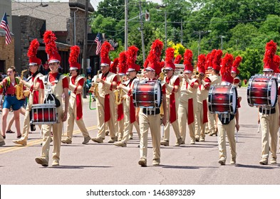 MENDOTA, MN/USA –JULY 13, 2019: Drummers lead the Henry Sibley High School Marching Band as it performs in the street at annual Mendota Days Parade.
