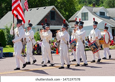 MENDOTA, MN/USA –JULY 13, 2019: Historic Fort Snelling fifes and drums corps marches in street at annual Mendota Days Parade.