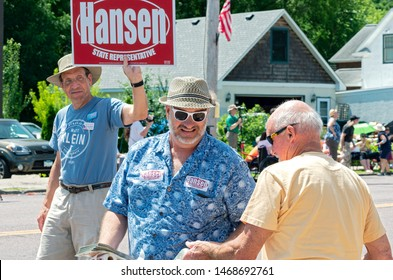 MENDOTA, MN/USA –JULY 13, 2019: Minnesota State Representative Rick Hansen of the Democratic Farmer Labor Party greets constituent at Mendota Days Parade.