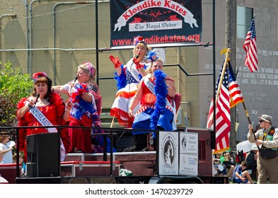 MENDOTA, MN/USA –JULY 13, 2019: Royal Order of Klondike Kates sings to crowd from atop float at annual Mendota Days Parade.