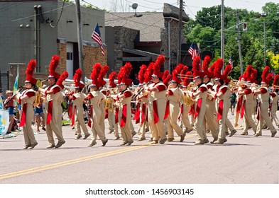 MENDOTA, MN/USA –JULY 13, 2019: The Sibley High School Marching Band performs in the street at annual Mendota Days Parade.