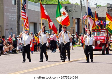 MENDOTA, MN/USA –JULY 13, 2019: St. Paul Osman Shrine Legion of Honor marches at annual Mendota Days Parade.