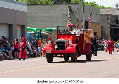 MENDOTA, MN/USA –JULY 13, 2019: Vulcan Krewe of Saint Paul Winter Carnival tradition entertains spectators as motorcade leads at annual Mendota Days Parade.