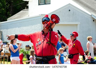 MENDOTA, MN/USA –JULY 13, 2019: Vulcan Krewe of Saint Paul Winter Carnival tradition entertains spectators at annual Mendota Days Parade.