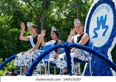MENDOTA, MN/USA –JULY 13, 2019: West Saint Paul Royalty waves to crowd from atop float at annual Mendota Days Parade.