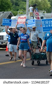 MENDOTA, MN/USA – JULY 14, 2018: Supporters of local candidates march in annual Mendota Days Parade holding campaign signs.