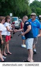 MENDOTA, MN/USA – JULY 14, 2018: Minnesota State Senator Matt Klein and State Representative Rick Hansen greet constituents at Mendota Days Parade.