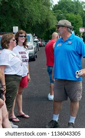 MENDOTA, MN/USA – JULY 14, 2018: Minnesota State Representative Rick Hansen greets constituents at Mendota Days Parade.