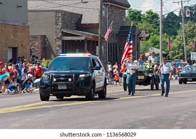 MENDOTA, MN/USA – JULY 14, 2018: Law enforcement and military veterans lead procession at annual Mendota Days Parade.