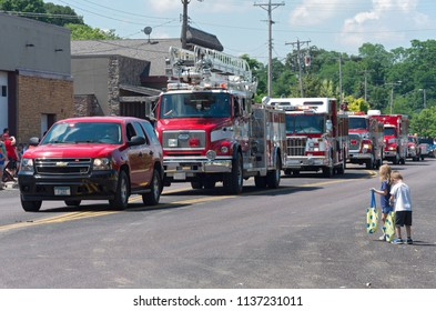 MENDOTA, MN/USA – JULY 14, 2018: Motorcade lineup of emergency vehicles at annual Mendota Days Parade.