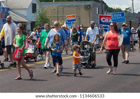 MENDOTA, MN/USA – JULY 14, 2018: Participants march in street at annual Mendota Days Parade.