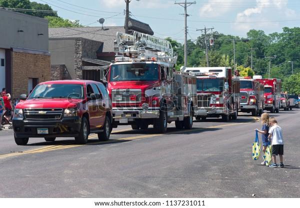 MENDOTA, MN/USA – JULY 14, 2018: Motorcade lineup of emergency vehicles at annual Mendota Days Parade.