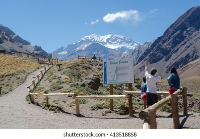 MENDOZA, ARGENTINA - JANUARY 14, 2015: Three unidentified people looking at the Aconcagua mountain.