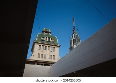 Mendoza, Argentina - January, 2020: View to Pasaje San Martin and top of tower called Edificio Gomez - highest building in Mendoza city. Rooftops of two most recognizable iconic buildings close up