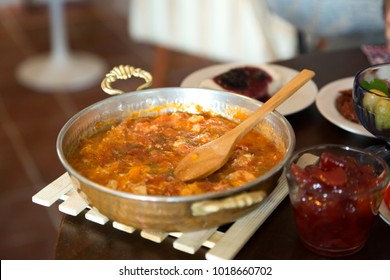 Menemen is a traditional Turkish dish which includes eggs, tomato, green peppers, and spices such as ground black pepper, ground red pepper, onion, garlic, feta cheese, ham, pastirma, salt and oregano