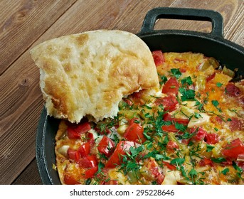 Menemen  - traditional Turkish dish.includes eggs, onion, tomato, green peppers, and spices .commonly eaten for breakfast