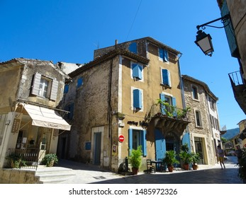 Menerbes / France - 07 17 2019 : charming street during sunny summer day in historic village Menerbes, one of touristic gems in Luberon valley, Vaucluse departement, Provence region, southern France
