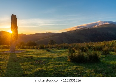 Menhir of Arlobi at sunset, Gorbea Natural Park, Alava, Spain