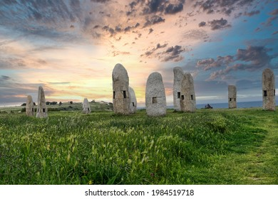The Menhires Pola Paz in a field under the sunlight during the sunrise in Spain - Shutterstock ID 1984519718